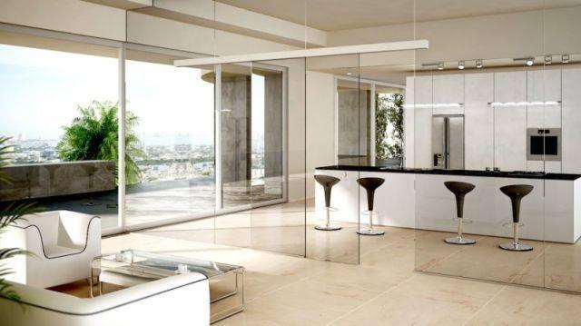 Cortinas de cristal para separar ambientes for Separar cocina de salon